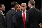 Republican presidential nominee Donald Trump stands with his family on the stage after the third presidential debate. Picture / AP