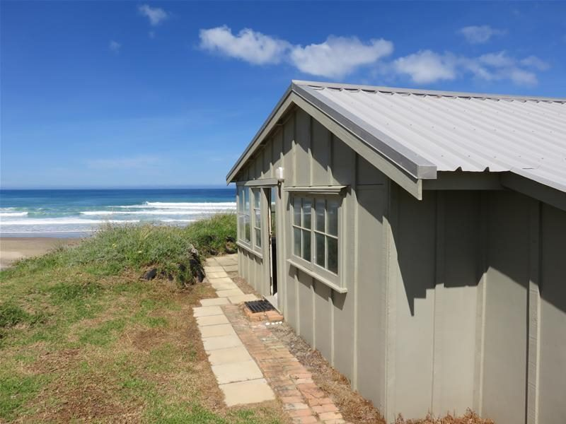 This bach in Baylys Beach is just over two hours from Auckland and has an affordable price tag of $289,000. Photo / supplied