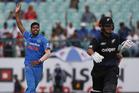 India's Umesh Yadav, center, celebrates the dismissal of New Zealand's Ross Taylor. Photo / AP