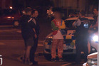 A man dressed as a clown was arrested in Dunedin last night after reports he was brandishing a machete. Photo / Shay Dewey - Southern Stringers