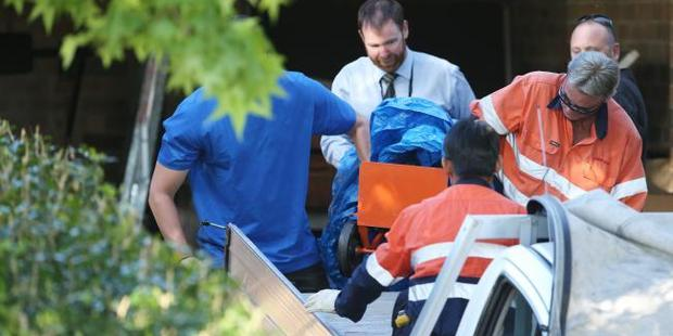 BOC Gases employees help police remove two gas cylinders from the home. Photo / Craig Greenhill, News Corp Australia