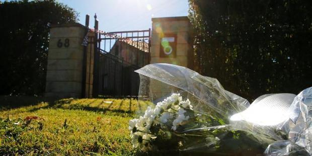 Flowers are being placed by locals outside the Davidson house where the family was found dead. Photo / John Grainger, News Corp Australia