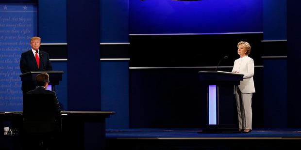 Moderator Chris Wallacespeaks as Donald Trump and Hillary Clinton listen during the third U.S. presidential debate in Las Vegas. Photo / Bloomberg, Daniel Acker