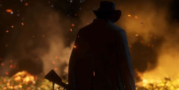 Towards the end of the Red Dead Redemption 2 trailer, a solo character is seen surveying a burning scene.