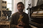 Joel Little accepts his Tui Award