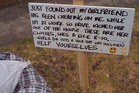 A cuckolded boyfriend packed all his partner's clothes and dumped them outside the house with a helpful sign for passers-by. Photo / Pinterest