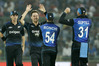 New Zealand's Matt Henry celebrates the dismissal of India's Kedar Jadhav. Photo / AP