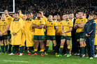 A dejected Wallabies team after last year's Bledisoe Cup clash at Eden Park. Photosport