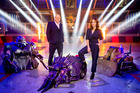 Robot Wars hosts Dar O'Briain and Angela Scanlon with some of the robotic hardware.