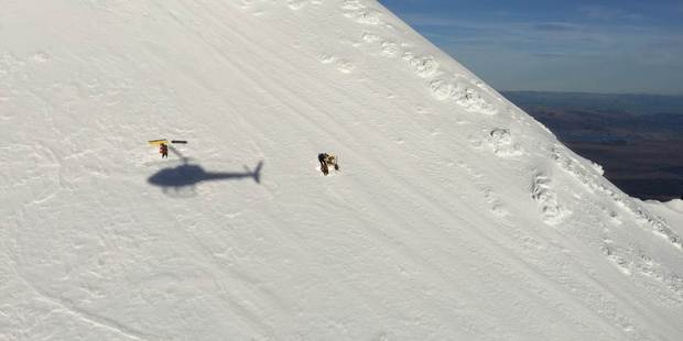 Ruapehu Alpine Rescue and Mt Ruapehu ski patrol were flown to the summit ridge and made their way down to the injured man. Photo / Greenlea Rescue Helicopter