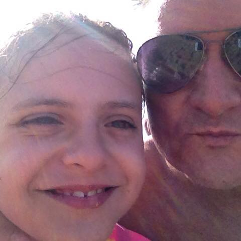 Elisa pictured with her father Fernando Manrique, who is believed to have killed his family. Photo / Facebook