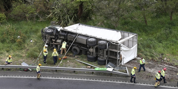 CRASH: A truck rolled onto its side on SH29 near the summit of the Kaimai Range. PHOTOS/JOHN BORREN