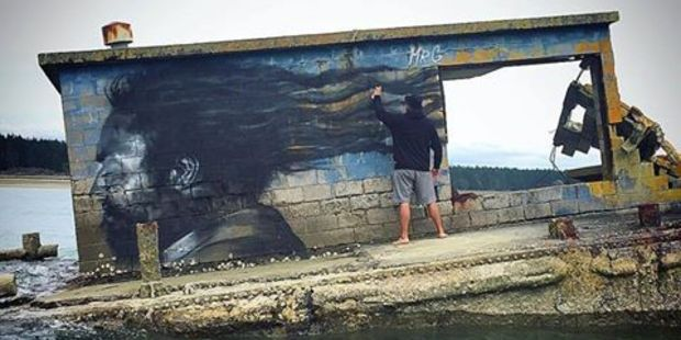 Mr G drawing Te Kahu Rolleston, a local poet and orator from Matakana Island on a stranded ammunition barge. Photo/supplied