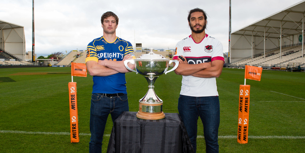 Otago captain Paul Grant and North Harbour captain Chris Vui stand beside the Mitre 10 Cup ahead of their Championship final in Dunedin tomorrow night. Photo / Photosport