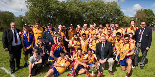 Sir Brian Lochore joins North Otago as they celebrate the win. Photo / Photosport