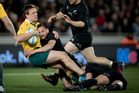 All Blacks Aaron Cruden and Ryan Crotty tackle Dane Haylett-Petty during the Bledisloe Test match. Photo / Dean Purcell