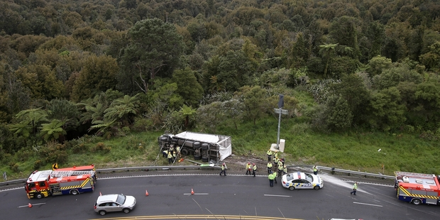 A truck rolled onto its side on SH29 near the summit of the Kaimai Range. Photo/John Borren