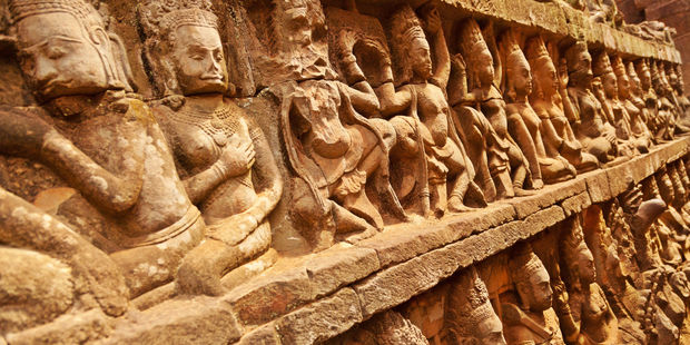 Figures carved into a wall at Angkor Wat in Cambodia. Photo / 123RF