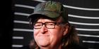 Michael Moore's act is part lecture, part performance art. Photo / AP