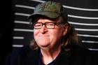 Michael Moore's act is part lecture, part performance art. Photo / AP