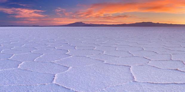 Sunrise over Bolivia's Salar de Uyuni - the world's largest salt flat. Photo / 123RF