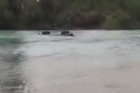 At least 30 4WD vehicles, two boats and a jet ski came to the rescue on Sunday after a Nissan Safari got stuck in a Canterbury river.