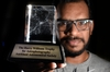LOW LIGHT: Amit Kamble with the trophy he won at the Harry Williams Astrophotography competition. PHOTO/GEORGE NOVAK