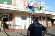 A police officer stands in front of the Dreamworld theme park on Gold Coast. Photo / AFP