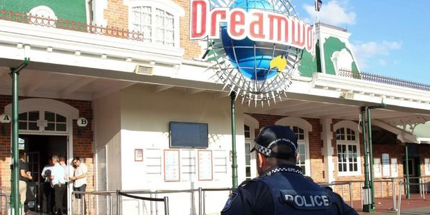 Loading A police officer stands in front of the Dreamworld theme park on Gold Coast. Photo / AFP