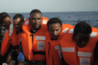 A rescue boat is filled with migrants taken from a vessel in the Mediterranean Sea off the coast of Libya. Photo / AP