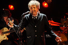 FILE - In this Jan. 12, 2012, file photo, Bob Dylan performs in Los Angeles. Dylan was named the winner of the 2016 Nobel Prize in literature Thursday, Oct. 13, 2016, in a stunning announcement that