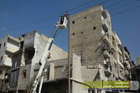 Syrian workers fix electricity cables after airstrikes, in Aleppo, Syria. Photo / AP