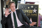 Actor Hugh Laurie strikes a pose as he receives his star on Hollywood's Walk of Fame. Photo/AP