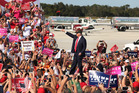 Donald Trump waves to cheering supporters at a Trump rally at Sanford Orlando International Airport in Florida. Photo / AP