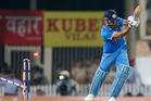 The bails fly, resulting in the dismissal of India's Mahendra Singh Dhoni, bowled by New Zealand's James Neesham during the fourth one-day international cricket match in Ranchi.