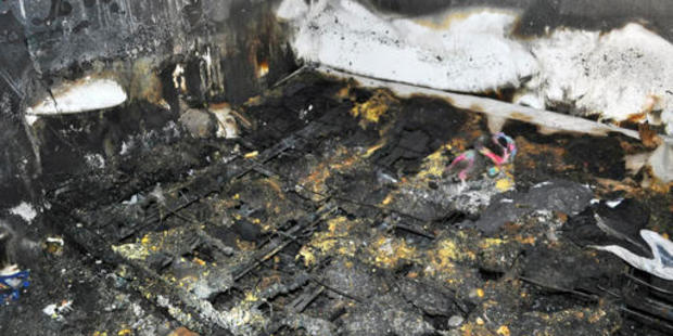 This photo provided by the Spokane Fire Department shows the bed where a toddler and his dog died in a fire. Photo / AP