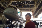 A flight attendant in front of Cathay Pacific's A350. Photo / Grant Bradley