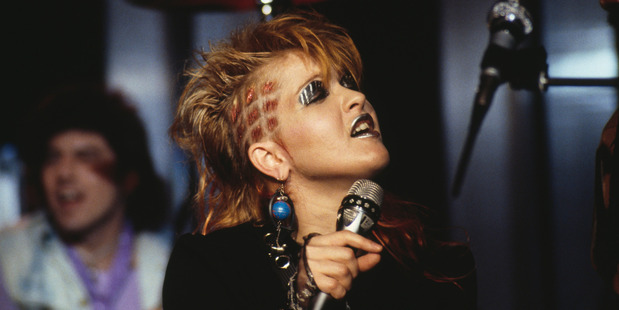 Cyndi Lauper, U.S. singer-songwriter, singing into a microphone, silver make-up on her lips and eyelids, at the Montreux Rock Festival, in Montreux, Switzerland, May 1984. Photo / Getty