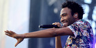 Actor/rapper Donald Glover (aka Childish Gambino) performs onstage during the 2014 iHeartRadio Music Festival Village. Photo / Getty
