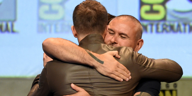 Actor Ryan Reynolds (L) embraces Deadpool director Tim Miller at the 20th Century FOX panel during Comic-Con. Photo / Getty