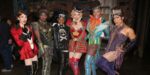 """Todrick Hall poses with """"The Angels"""" backstage at the hit musical Kinky Boots on Broadway at The Al Hirshfeld Theatre on March 23, 2016 in New York City. Photo / Getty"""