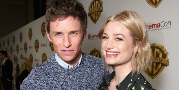 Actors Eddie Redmayne (L) and Alison Sudol of 'Fantastic Beasts and Where to Find Them' attends CinemaCon 2016 Warner Bros. Photo / Getty
