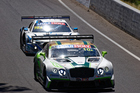 Garth Tander chases Steven Kane at the Bathurst 12 Hour race. Photo / Getty Images