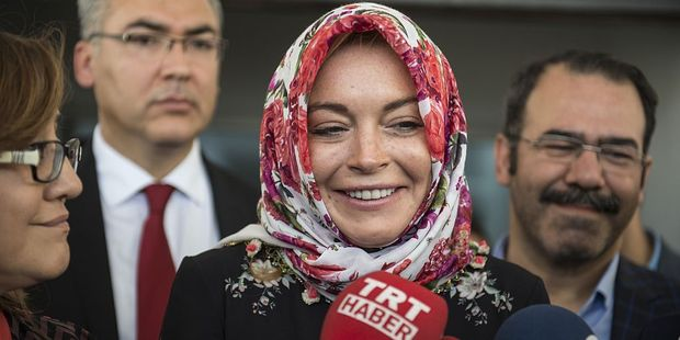 American actress Lindsay Lohan wears a headscarf given by a Syrian woman. Photo / Getty Images
