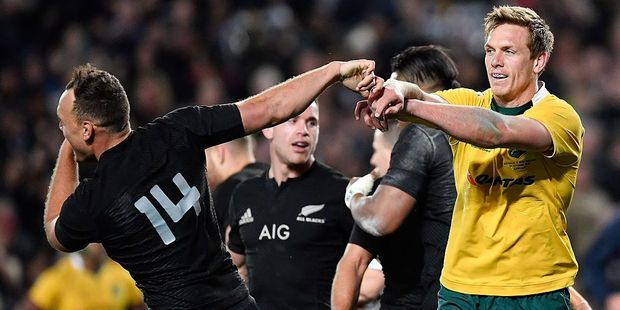 Dane Haylett-Petty of the Wallabies pushes Israel Dagg of the All Blacks. Photo / Getty