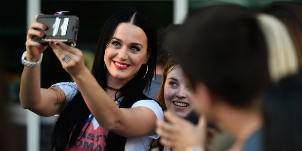 Singer Katy Perry greets people after speaking at a get out the early vote rally as she campaigns for Democratic presidential candidate Hillary Clinton. Photo / Getty