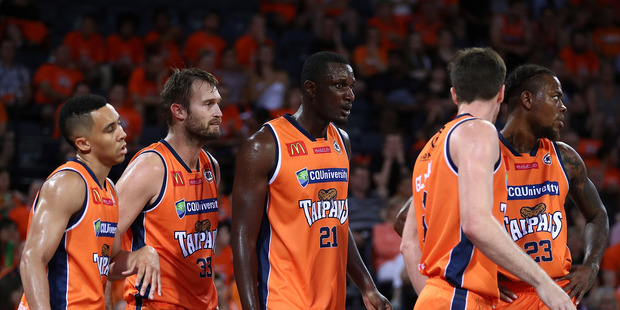 Taipans players talk during the round four NBL match against Melbourne United. Photo / Getty Images