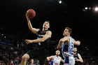 Kirk Penney takes the ball to the hoop during the Breakers' big win over Adelaide. Photo / Getty