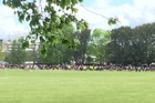 Children from Hamilton's Hillcrest High School are gathered on the school field. Photo / Belinda Feek
