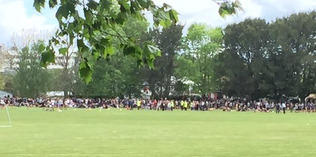 Children from Hamilton's Hillcrest High School are gathered on the school field. Photo / Belinda Feek